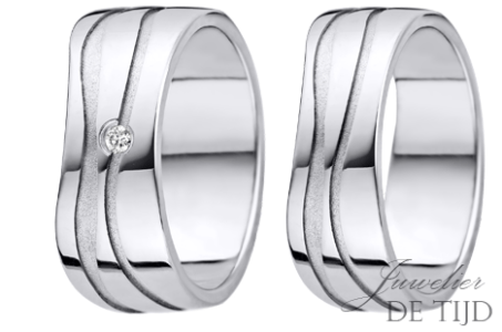 Palladium trouwringen 8mm breed, met één briljant geslepen diamant