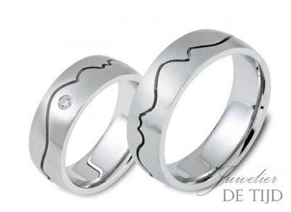 Edelstalen trouwringen 7mm breed, met briljant geslepen diamant