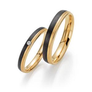 Abrikoos gouden met carbon Trouwringen met 1 briljant geslepen diamant