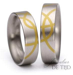 Platina trouwringen ingelegd met puur goud 24 karaats