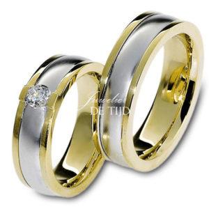 Bi-color geel/wit gouden trouwringen 6,5mm breed met één briljant