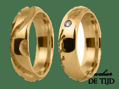 Geel gouden trouwringen met 1 briljant geslepen diamant