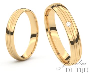 Geel gouden trouwringen 4,0mm breed met 1 briljant geslepen diamant