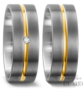 Titanium met geel goud trouwringen 8mm breed met 1 briljant geslepen diamant