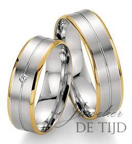 Bi-color wit/geel gouden trouwringen 6mm breed met 1 briljant geslepen diamant