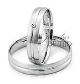 Wit gouden trouwringen 4mm breed met 1 briljant geslepen diamant
