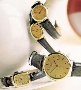 14 karaats geel gouden horloge met leren band