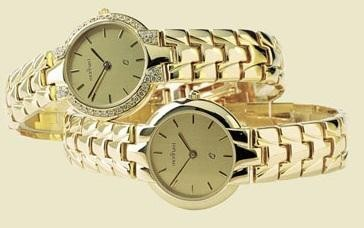 14 karaats geel gouden dames horloge met gouden band en briljant