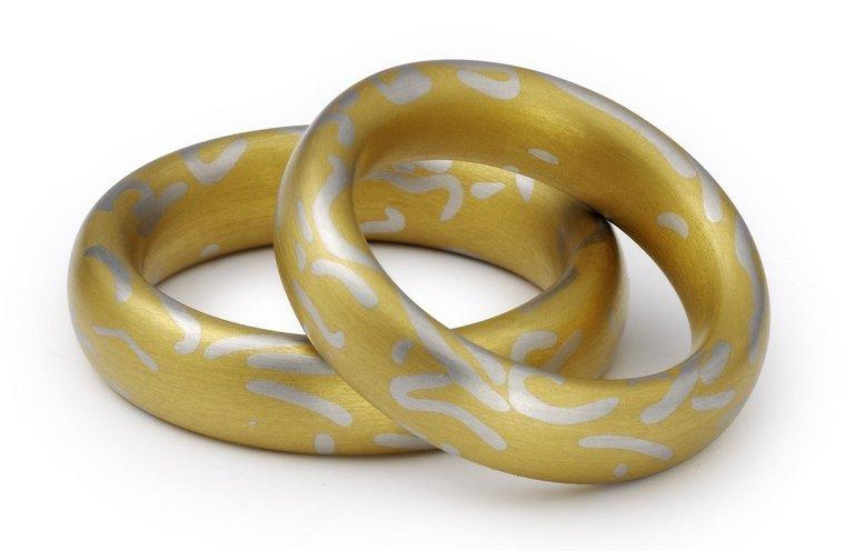 Unieke platina Trouwringen Lava ® met puur 24 karaats goud