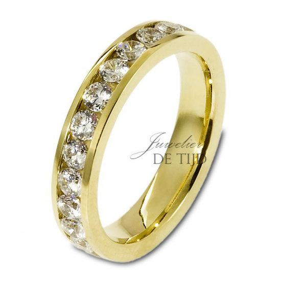 Geel gouden trouwringen 4mm breed met 26 briljanten