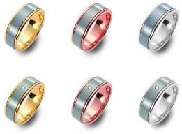 Bi-color titanium/rood gouden trouwringen 6,5mm breed met één briljant