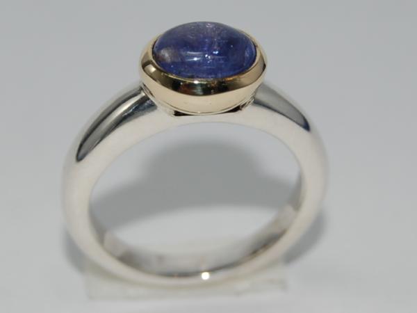 Zilveren met gouden handgemaakte ring met tanzaniet