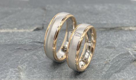 Bicolor trouwringen baguette geslepen diamant