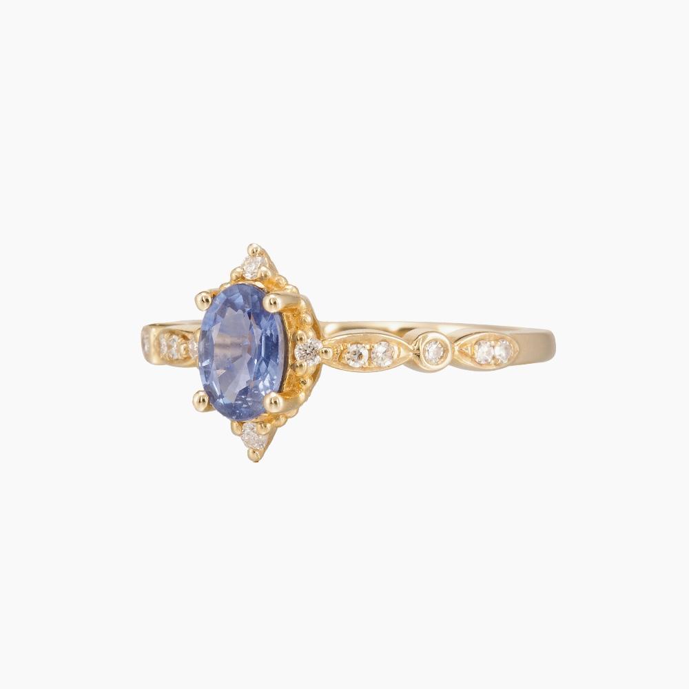 14 karaats geelgouden verlovingsring met blauwe saffier